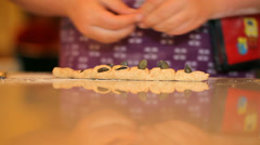 Little girl kneading dough (People), 2 shots Stock Footage