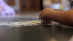 Little girl kneading dough (People) Stock Footage
