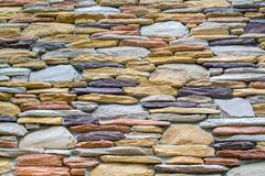 Wall with colorful stone in stack as texture Stock Photos