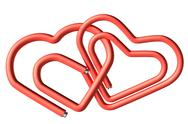 Stock Photo of red paperclips heart couple