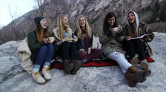 Five Teen Girls Bundled Up, Hanging Out, Having Fun On A Big Rock Stock Footage