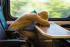 Sleeping woman in train Stock Photos
