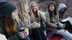 Five Teen Girls Bundled Up Outdoors, Sitting & Talking Stock Footage
