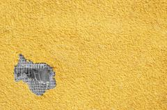 yellow rough stucco, deeply punched. material texture. - stock photo