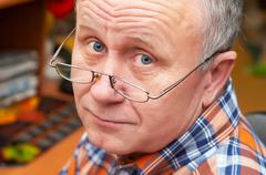 Casual senior man with glasses. emotional portrait series. Stock Photos