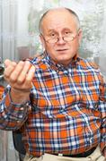 casual bald senior man emotional portrait series. - stock photo