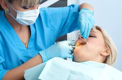 Dentist at work, anesthesia injection Stock Photos