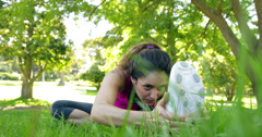 Woman stretching her legs before a jog in the park Stock Footage