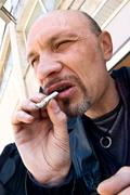 typical criminal with cigarette - stock photo