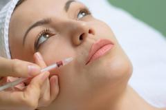 Beauty treatment, botox injection Stock Photos