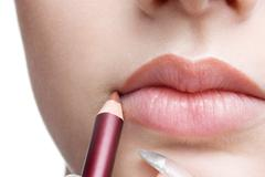 making up lips contour - stock photo