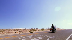 Biker on Route 66 plus sign (Cities) Stock Footage