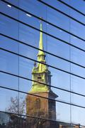 Architecture of London, business district, reflect of a church on a building Stock Photos