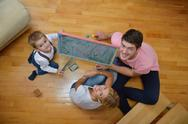 Stock Photo of family drawing on school board at home