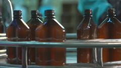 Line for bottling liquid products in plastic bottles. Plastic crates on conveyor Stock Footage