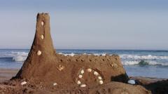 Sandcastle on beach Stock Footage