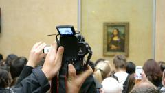 Stock Video Footage of Mona Lisa (Gioconda) by Leonardo DaVinci, Louvre Museum, Paris, France.
