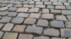 Paving stone. Road of cobblestones closeup. Stock Footage