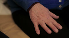 Two pairs of hand touch each other, together, helping hands Stock Footage