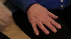 A young hand comforts and elderly hand Stock Footage