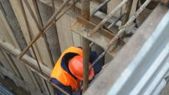 Worker down stairs to collector - stock footage