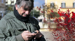 Man Texting On Smartphone Wearing Winter Clothes Stock Footage