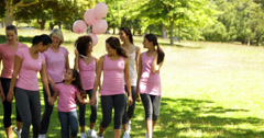 Women going on a walk for breast cancer awareness in the park Stock Footage