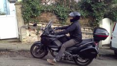 Motorbike courier arrives fast on large cruiser type bike version 2. Stock Footage