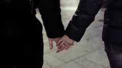 Couple hands closed together outdoors. Hand-in-hand Stock Footage