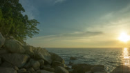 Stock Video Footage of rocky shore of tropical ocean at sunset