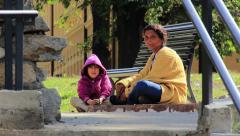 Homeless mother and child begging Stock Footage