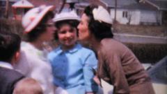 Stock Video Footage of Aunt Kissing Kids In Driveway-1962 Vintage 8mm film