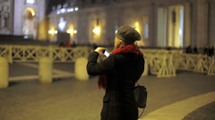 Young woman taking a photo with her cell phone camera while traveling Stock Footage