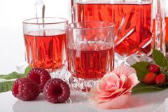 Proposition of serving raspberry liqueur Stock Photos