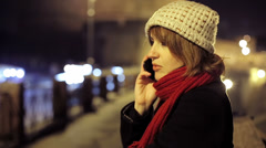 Woman using smartphone in city at night Stock Footage