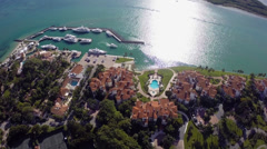 Boat leaving Fisher Island aerial video footage Stock Footage