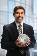 Hispanic businessman holding earth Stock Illustration