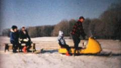 Family Using Snowmobile In Winter-1964 Vintage 8mm film Stock Footage