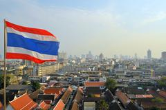 Bangkok city by day view with thai flag Stock Photos