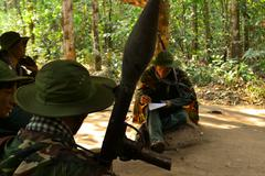 vietcong fighters in the jungle - stock photo
