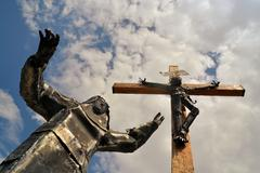 Christ staue with virgin mary wailing at his feet Stock Photos