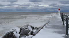 Ice covered small pier, small lighthouse, Great Lakes WInter - stock footage