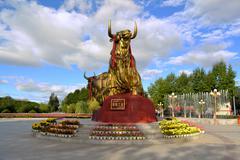 Golden tibetan yak statue in lhasa, tibet Stock Photos