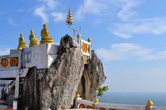 Buddhist mountainpeak temple in thailand Stock Photos