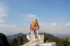 buddhist mountainpeak temple in thailand - stock photo