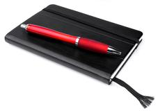 Studio shot of a black personal organizer with red pen - stock photo