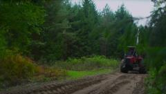 Stock Video Footage  tractor driven forest along a forest road 4K Stock Footage
