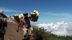 Porters with heavy baskets of sulfur. Java, Indonesia Stock Footage