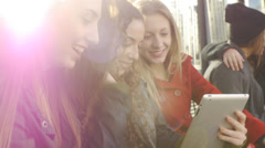 Lens Flare Shot Of Six Teen Girls Waiting At A Station With A Phone And A Tablet - stock footage