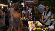 Stock Video Footage of Chiang Mai holyday streets. Loi Krathong sellers, market, Thai